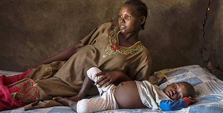 Sarah Kiden, 18, and her son are affected by the famine (Caritas/Ivy Njiokiktjien)