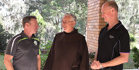 YMT national director Steve Toohey, left, Discalced Carmelite regional councillor Fr Paul Maunder OCD and retreat centre general manager John Ransom (Supplied)