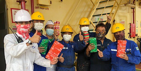 Seafarers with care packs from Stella Maris Australia (ACBC)