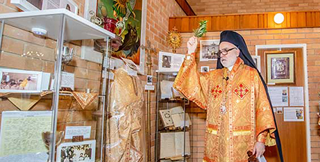 Bishop Robert Rabbat blesses the Melkite heritage display at St Michael's Melkite Cathedral in Darlington, in Sydney (The Catholic Weekly/Giovanni Portelli)