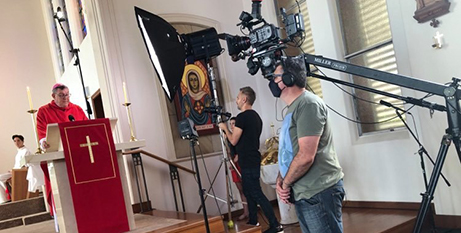 Bishop Brian Mascord and a production team from the Wollongong Diocese film Mass for You at Home (Wollongong Diocese)