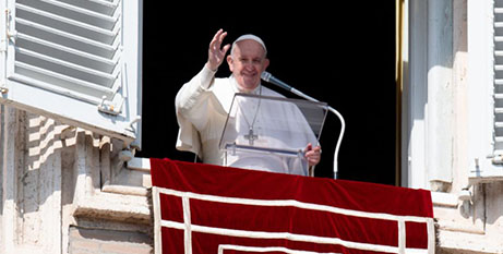 Pope Francis greets the crowd during the Angelus address on Sunday (CNS/Vatican Media)