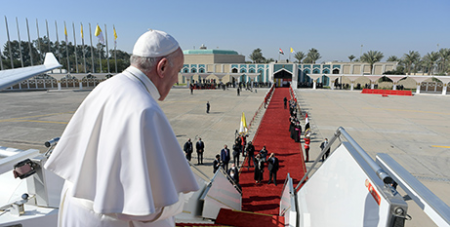 Pope Francis looks back from the stairs of the papal plane at Baghdad International Airport yesterday, before departing on his flight to Rome (CNS/Vatican Media via Reuters)