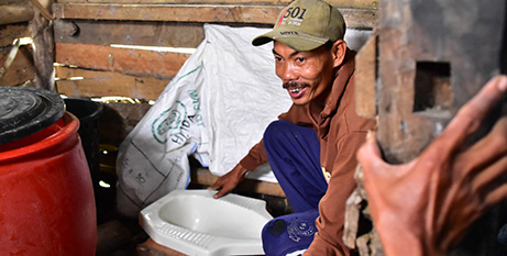 Arsad helps a neighbour build a toilet at his home in Pandeglang District, about 150km west of Jakarta (Caritas Australia)