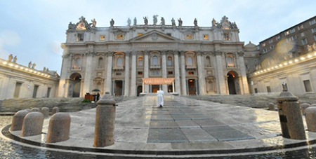 Pope Francis arrives for a prayer service in an empty St. Peter