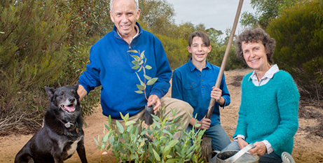 Peter, Luke and Ann Henry with their dog Tip on their farm near Tailem Bend, South Australia (The Southern Cross/Nat Rogers)