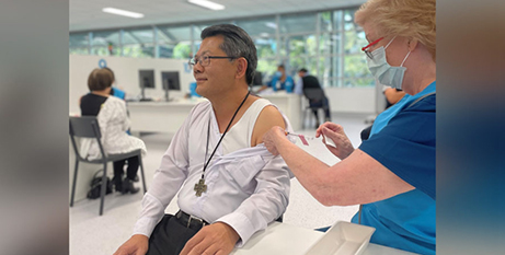Bishop Vincent Long OFM Conv receiving the COVID-19 vaccine (Supplied)