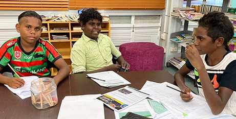 Jerese William, Ferguson Williams and Hamish Gothakchalkenin are doing their learning at Pormpuraaw State School library under supervision while St Teresa's College remains closed (St Teresa's College, Abergowrie)