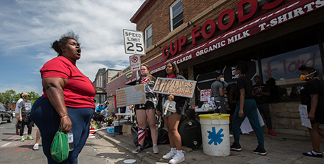 Protesters at the site in Minneapolis where George Floyd was killed on May 25 (CNS photo/Dave Hrbacek, The Catholic Spirit)