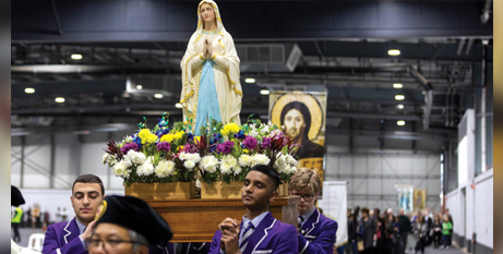 Students from Christian Brothers College, Adelaide, carry a statue of Mary into the peace rally (The Southern Cross/Ben Macmahon)