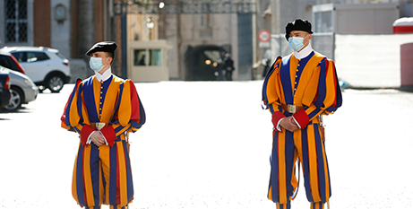Swiss Guards stand guard at the Vatican in May (CNS/Remo Casilli, Reuters)