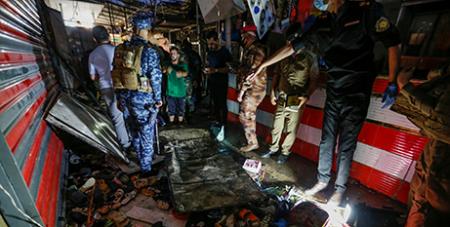 Iraqi security forces at the site of a suicide bombing at the al-Wuhailat market in Baghdad on July 19 (CNS/Wissam Al-Okaili, Reuters)