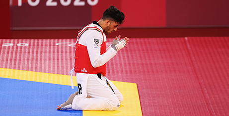Refugee Olympic Team member Abdullah Sediqi reacts after competing in the Taekwondo Men