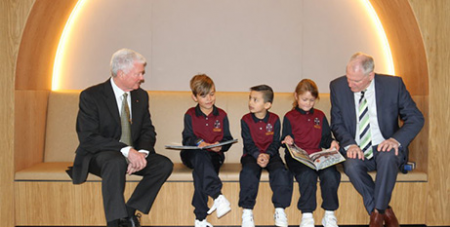 Tenison Woods Catholic School students with Fr Philip Marshall (left) and Catholic Education SA assistant director Bruno Viecelie at the fee reduction annoucement last week (The Southern Cross)