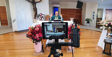 A Mass celebrated by Fr Lam Vu is livestreamed from Our Lady of the Rosary church in Caloundra, Queensland, in June  (The Catholic Leader/Fr Josh Whitehead)