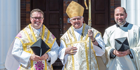 Newly-ordained Oratory Father Conor Power with Archbishop Mark Coleridge and Oratory Father Adrian Sharp. (Alan Edgecomb/Catholic Leader)