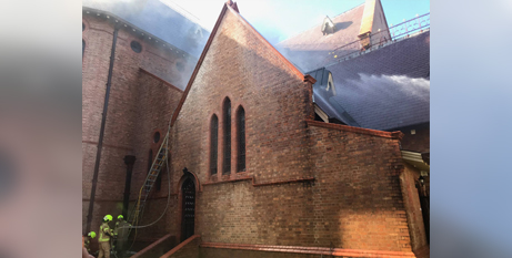 Firefighters work to extinguish the fire at St Carthage's Cathedral in Lismore on Friday (NSW Fire and Rescue)