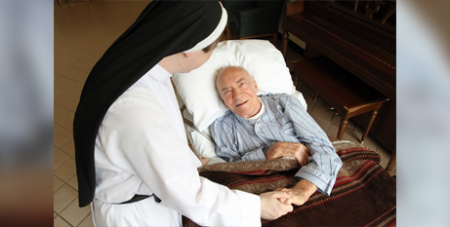 A patient is pictured in a file photo chatting with a nun at a New York palliative care facility (CNS/Gregory A. Shemitz)