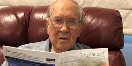 Gilbert Alison with a copy of The Far East (The Catholic Leader)