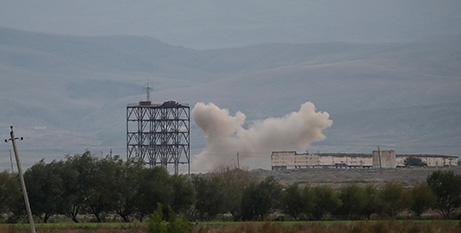 Azerbaijan forces shell Armenian targets during the fighting over the breakaway region of Nagorno-Karabakh near the city of Terter, Azerbaijan(CNS/Umit Bektas, Reuters)