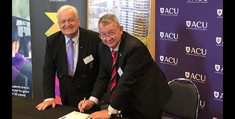 Tony Bleasdale, left, and Professor Greg Craven officially sign off on the blueprint for the new ACU Blacktown campus (Supplied)