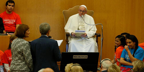 Pope Francis listens as a couple asks a question during the release of the 'Sharing the Wisdom of Time' book in 2018 (CNS/Paul Haring)