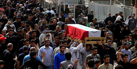 Funeral procession for a a demonstrator killed during an anti government-protest in Najaf on Monday (CNS/Alaa al Marjani, Reuters)
