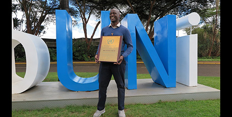 Br Peter Mokaya Tabichi with his Person of the Year award at the UN headquarters in Nairobi, Kenya (CNS/United Nations in Kenya)