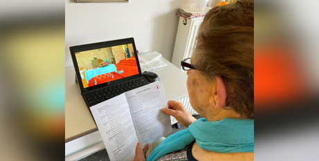 An aged care resident attends an online funeral (VMCH)