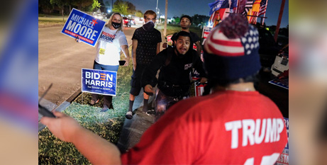Rival supporters outside a polling site in Houston, Texas, yesterday (CNS/Go Nakamura, Reuters)