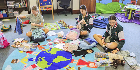 Mercedes College students fill the Sunshine Packs with items for children in out-of-home care (The eRecord/Supplied)