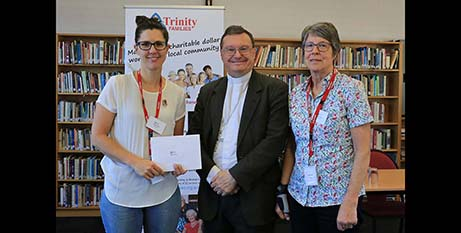 Bishop Pat O'Regan presents a cheque to Olivia's Place representatives Kirsten Finger and Robyn Bayley (Sale Diocese)