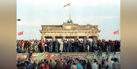 People stand atop the Berlin Wall in front of the Brandenburg Gate on November 10, 1989 (CNS/David Brauchli, Reuters)