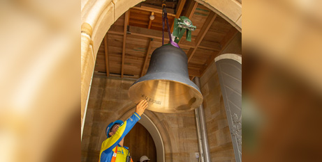 A bell is lifted into place in the St Patrick