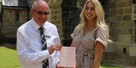 John Thomas and Marnie Hewitt with the Gen Z Prayer Book (The Catholic Leader)
