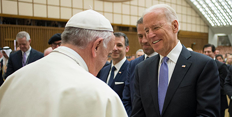 Pope Francis greets then US vice president Joe Biden at the Vatican in 2016 (CNS/L'Osservatore Romano)