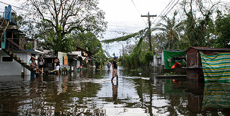 Locals wade through floodwaters after Typhoon Vamco (]NASSA/Caritas Philippines)