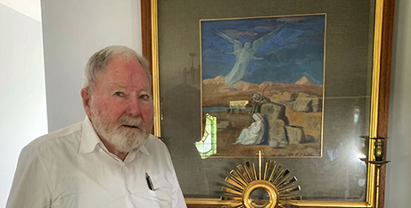 Fr John Browne with 'Flight into Egypt' (The Catholic Leader)