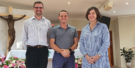 Kevin Donahoe (left), Fr Josh Whitehead and Jacinta Elks (The Catholic Leader)