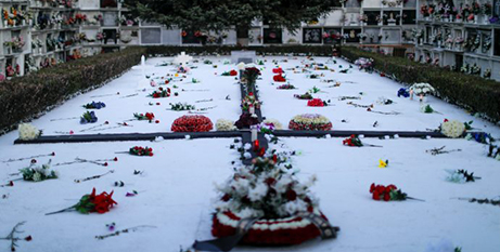 Flowers are seen on a mass grave of people killed during and after the 1936-1939 Spanish Civil War in Ronda, Spain (CNS/Jon Nazca, Reuters)