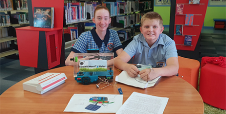 Columba Catholic College students Tegan and Colby with the irrigation system (Townsville Catholic Education)