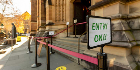 St Mary's Cathedral with a COVID-19 sign-in line (The Catholic Weekly/Patrick J Lee)