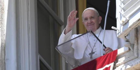 Pope Francis waves to the small crowd in St Peters Square during his Angelus address on Sunday (Vatican Media)